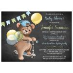 Cute chalkboard baby shower invitation with brown bear wearing a denim ball cap while riding a scooter with blue, green, and yellow balloons and bunting.
