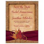 ​Rustic brown burlap wedding save the date magnet with a burgundy wine colored ribbon, a gold tone twine bow, and burnt orange, red, and rust autumn leaves on it.