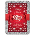 Red and silver gray floral wedding invitation with red ribbon, bow, joined jewel and glitter hearts brooch and ornate scrolls.