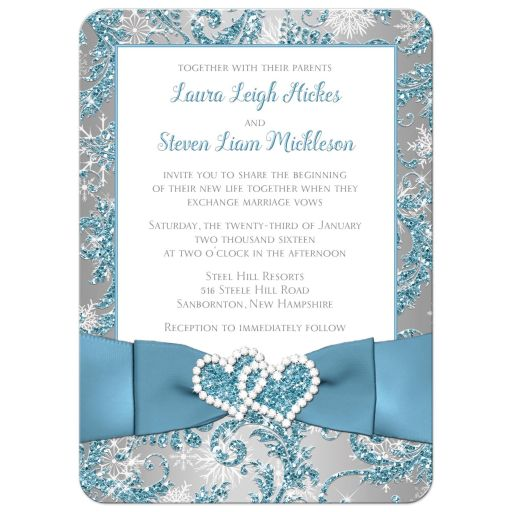 Winter wonderland wedding invite in ice blue, silver and white snowflakes with joined jewelled hearts