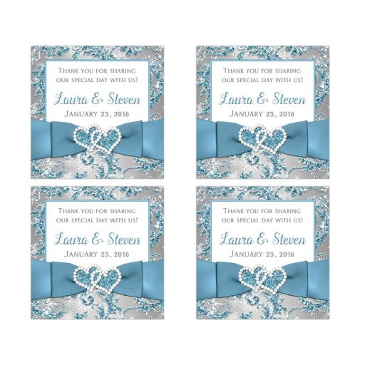 Great winter wonderland wedding favor stickers with ice blue ribbon and joined jewel hearts