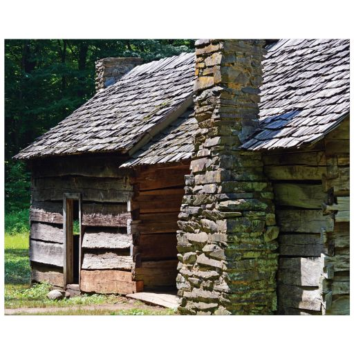 Old wood house with stone chimney color photograph