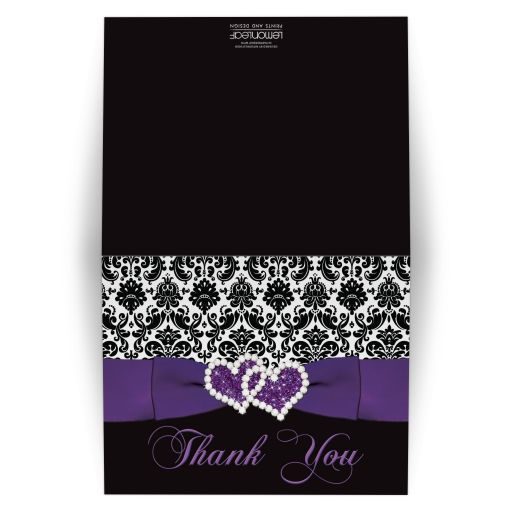 Great purple, black, and white damask pattern wedding  thank you cards with ribbon, bow and jewelled joined glitter hearts on it.