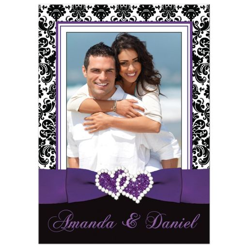 ​Best purple, black, and white damask pattern photo template wedding invite with ribbon, bow, glitter and a jewelled joined hearts buckle brooch on it.