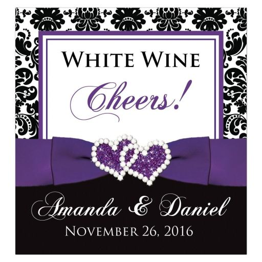 ​Great purple, black, and white damask pattern wedding reception wine bottle, beer bottle, or other beverage bottle label with ribbon, bow and jewelled joined glitter hearts on it.