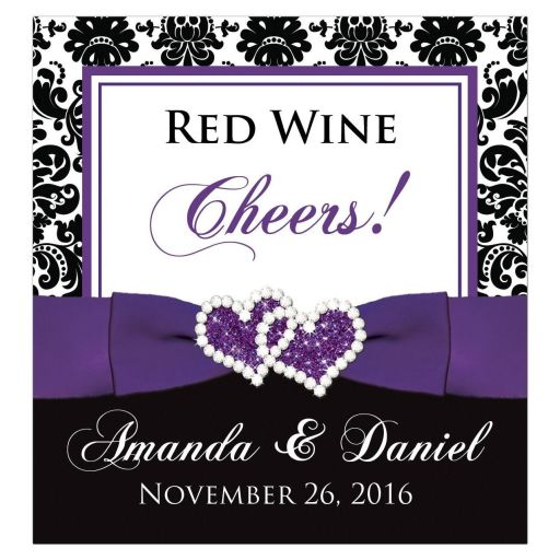 ​Best purple, black, and white damask pattern wedding reception wine bottle, beer bottle, or other beverage bottle label with ribbon, bow and jewelled joined glitter hearts on it.