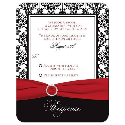 Great black and white damask pattern wedding r.s.v.p. cards with red ribbon and crystal buckle brooch.
