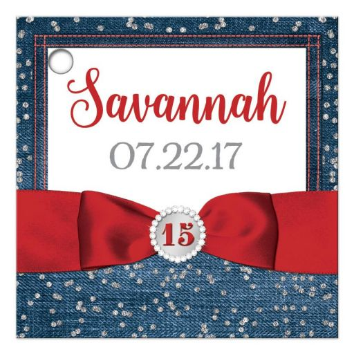 Personalized red, white and blue denim and diamonds Quinceanera party favor gift tags with silver glitter confetti, red ribbon and bow, decorative tiara, and a round faux diamonds and silver buckle brooch with 15 on it.