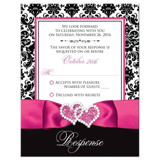 Hot pink, black, and white damask pattern wedding response cards with ribbon, bow, scroll, and jeweled double hearts buckle brooch.