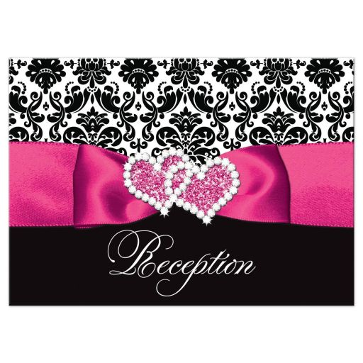 Hot pink, black, and white damask pattern wedding reception enclosure card with ribbon, bow, scroll, and jeweled joined hearts buckle brooch.