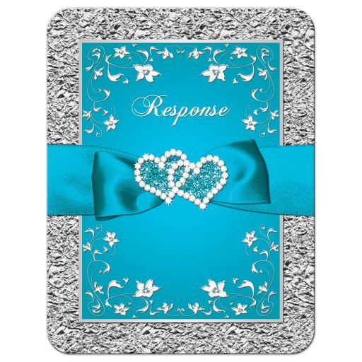 Turquoise blue and silver gray floral wedding response cards with teal ribbon, bow, and glittery crystal jewels double hearts buckle brooch with silver foil border.
