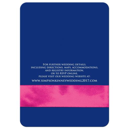 Navy blue, pink, and white floral pattern wedding invites with ribbon, glitter and a pair of jewelled double joined hearts buckle brooch on it.