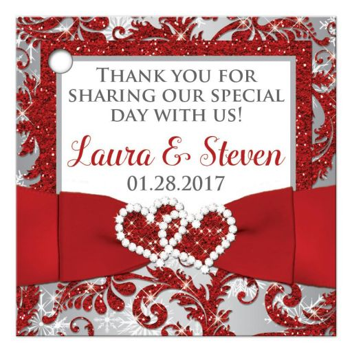 Personalized winter wonderland wedding favor thank you tag in red, silver grey, and white snowflakes with ribbon and joined jewel and glitter hearts.