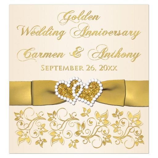 ​50th wedding anniversary wine or beverage bottle label with joined jewel and glitter hearts, gold ribbon, bow, scrolls, and flowers on an ivory background.