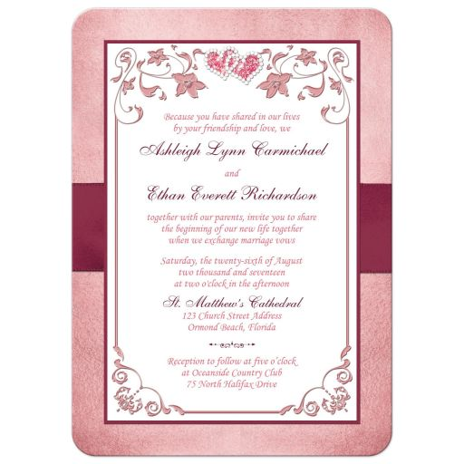 Burgundy, blush pink, rose gold and white floral wedding invite with burgundy ribbon, bow, and glittery crystal jewels double hearts buckle brooch with rose gold metallic border.