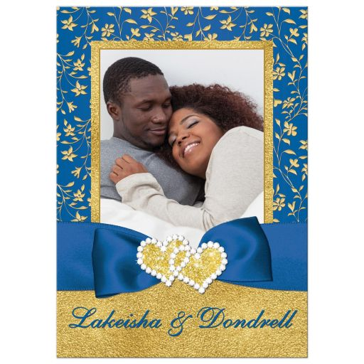 Royal blue and gold foil and floral photo template wedding invitation with joined jewel and glitter hearts, ribbon and bow.