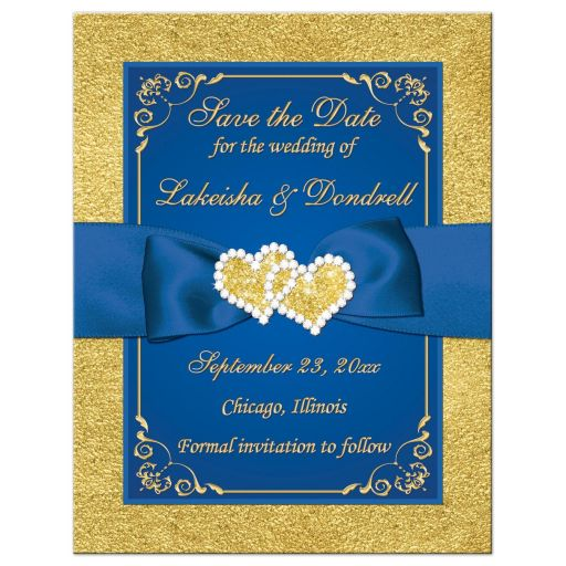 Royal blue and gold foil and floral wedding photo save the date card with joined jewel hearts and ribbon.