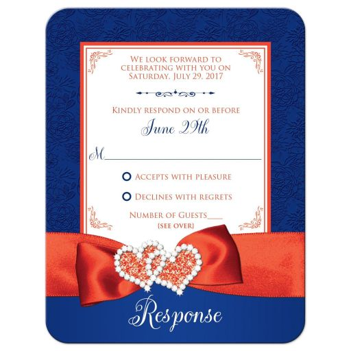 R​oyal blue, orange, and white floral pattern wedding response enclosure cards with ribbon, bow, glitter and a pair of jeweled double joined hearts buckle brooch on it.