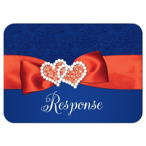 ​Royal blue, orange, and white floral pattern wedding response enclosure card inserts with ribbon, bow, glitter and a pair of jeweled double joined hearts buckle brooch on it.