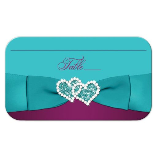 Plum purple, teal blue and magenta pink floral wedding place card or escort cards with ribbon, bow, glitter, and jeweled joined hearts.