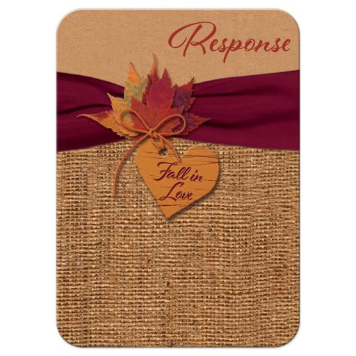 Burlap and Kraft paper wedding response enclosure card insert with a burgundy wine ribbon, orange painted wood heart, a twine bow, and burnt orange, red and rust autumn leaves on it.​