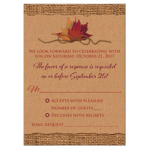Burlap and Kraft paper wedding rsvp card with a burgundy wine ribbon, orange painted wood heart, a twine bow, and burnt orange, red and rust autumn leaves on it.​