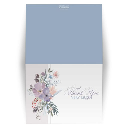 Watercolor wildflowers wedding thank you card that features a beautiful array of wildflowers and greenery in shades of smokey blue, lavender purple, plum, peach, taupe and green on a white and pale taupe grey background.