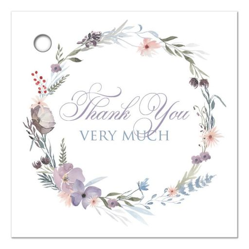 "2.5"" square watercolor wildflowers wedding favor thank you tag features a beautiful round wreath of wildflowers and foliage in shades of dusty blue, lavender purple, smokey plum, peach, taupe and green on a white background."