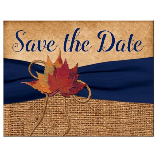 Rustic brown burlap photo template wedding save the date postcard with a navy blue colored ribbon, a twine bow, and burnt orange, red, and rust autumn leaves on it.