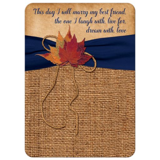 ​Rustic brown burlap wedding invitation with a navy blue ribbon, a twine bow, and burnt orange, red and rust autumn leaves on it.