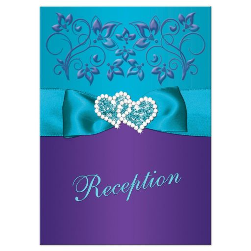 Purple and teal blue floral wedding reception enclosure card insert with turquoise blue ribbon, bow, jeweled joined hearts, ornate scrolls and flourish.