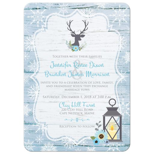 Rustic blue and white snowflakes winter wedding invitation with blue flowers, gray deer head, grey lantern, and wood.