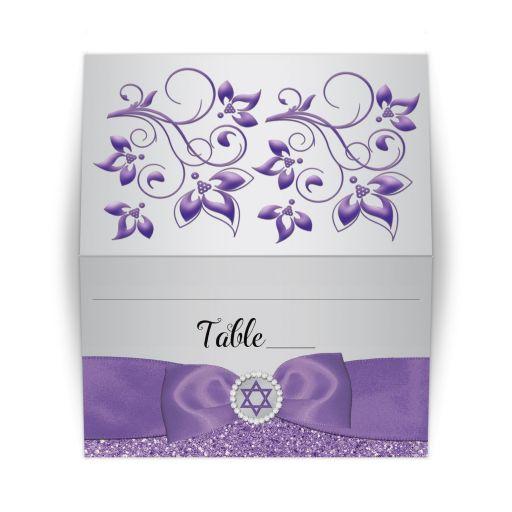 Black, silver gray, and purple Bat Mitzvah place card with purple ribbon, bow, jewels, glitter, and Jewish Star of David on it.