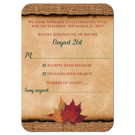 ​Rustic burlap wedding RSVP enclosure cards with a hunter green ribbon, a golden twine bow, and burnt orange, red and rust autumn leaves on it.