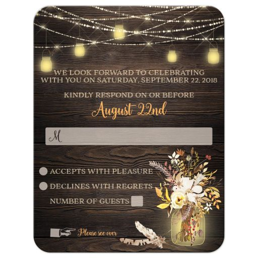 Rustic wedding response enclosure card insert with brown wood, mason jars, string lights and ivory, yellow, and orange flowers, foliage, and feathers for an autumn wedding.