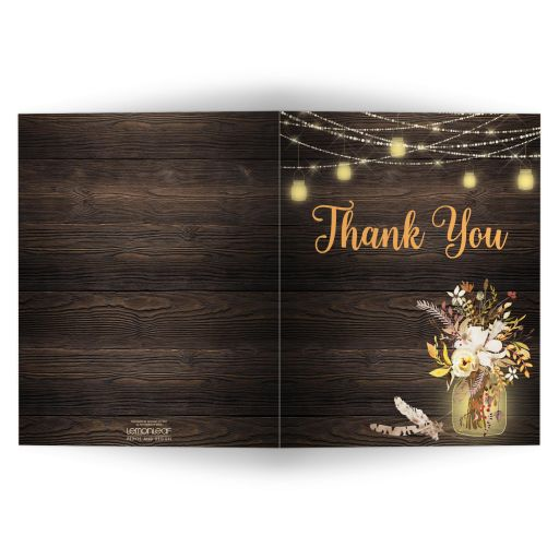 Rustic Brown, Yellow, Ivory, Orange Floral, String Lights, Mason Jars on Simulated Wood wedding thank you note card.