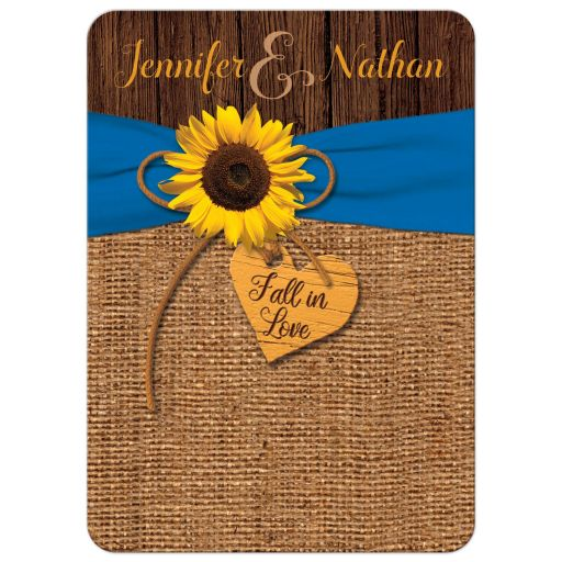 Rustic burlap and wood autumn wedding invitation with a cobalt or french blue ribbon, a twine bow, and sunflower on it with a wood heart that says Fall in Love on it.