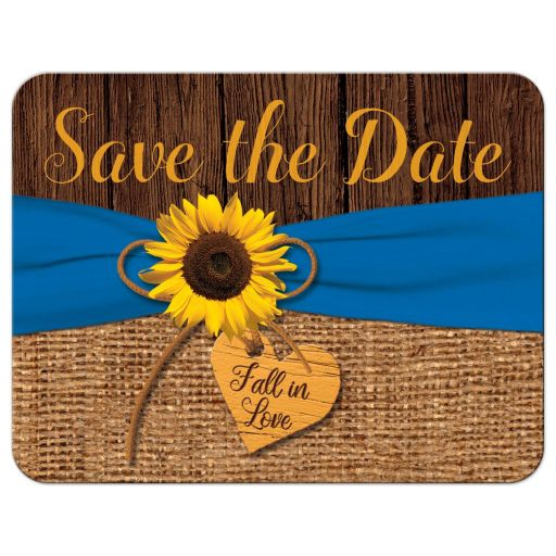 ​Rustic burlap and wood autumn wedding save the date post card with a cobalt or royal blue ribbon, bow, and sunflower on it with a wood heart that says Fall in Love on it.