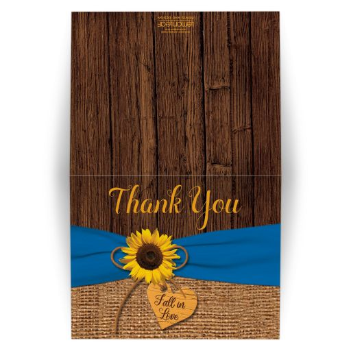 Rustic burlap and wood sunflower fall in love wedding thank you card with a cobalt or french blue ribbon, a twine bow, and a wood heart on it.