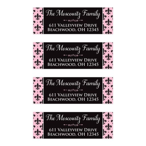 Pink, black, and white return address mailing labels with the French fleur-de-lis pattern on them.