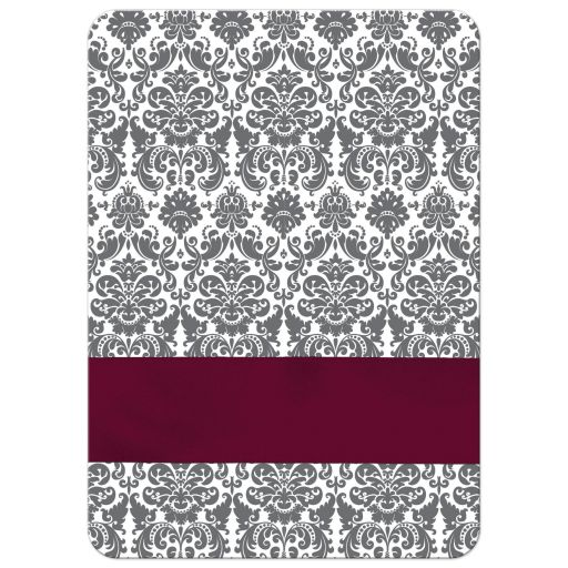 Burgundy wine, charcoal gray and white damask pattern wedding invitation with ribbon, bow, glitter and a jeweled joined hearts buckle on it.