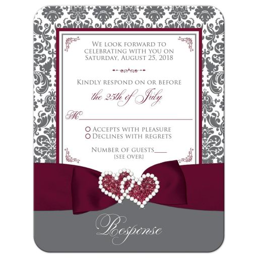 Burgundy wine, grey gray and white damask pattern wedding response, reply, RSVP card with ribbon, bow, glitter and a jewelled joined hearts buckle on it.