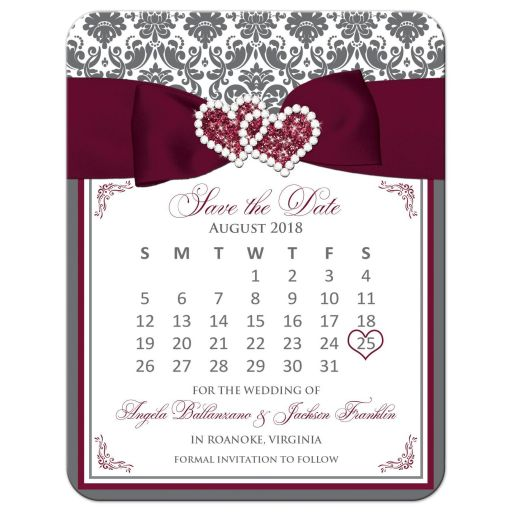 ​Burgundy wine, grey gray and white damask pattern wedding save the date card with ribbon, bow, glitter and a jeweled joined hearts buckle on it.