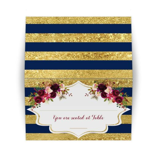 Folded navy blue, gold, burgundy wine, white striped wedding place card or escort card with watercolor flowers and garland.