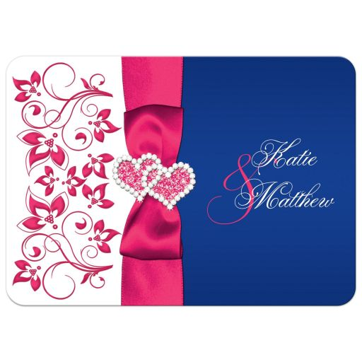 Royal blue, fuchsia pink, and white floral wedding invitation with ribbon, bow, glitter, jewels double joined hearts buckle brooch on it.