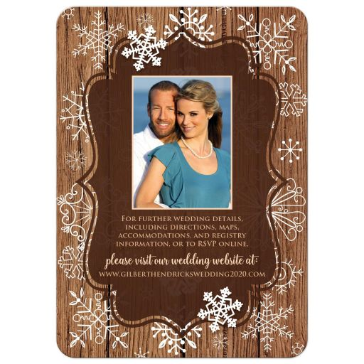 Rustic brown wood grain look winter wedding invite with white whimsical hand drawn snowflakes and photo template.
