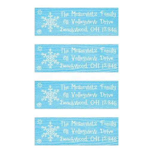 Blue and white whimsical snowflakes on rustic wood grain look return address mailing labels for a winter Bat Mitzvah or other party.