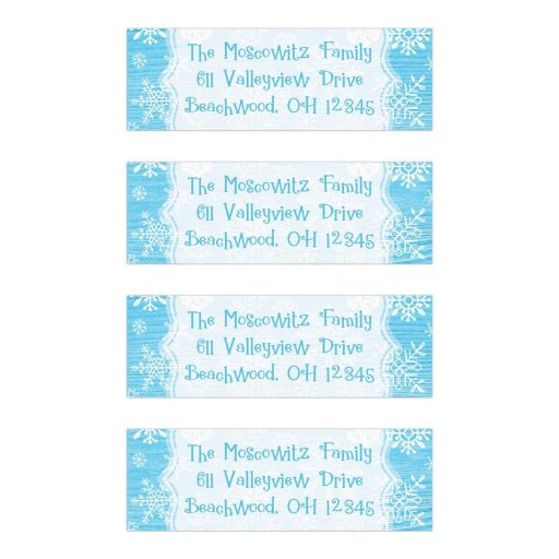 ​Blue and white whimsical snowflakes on rustic wood grain look return address mailing labels for a winter Bat Mitzvah or other party.