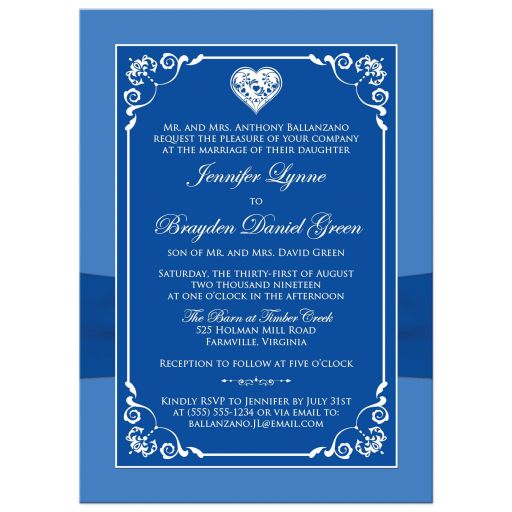 Royal blue and white floral wedding invitation with silver heart brooch, ribbon, flowers, and ornate scrolls.