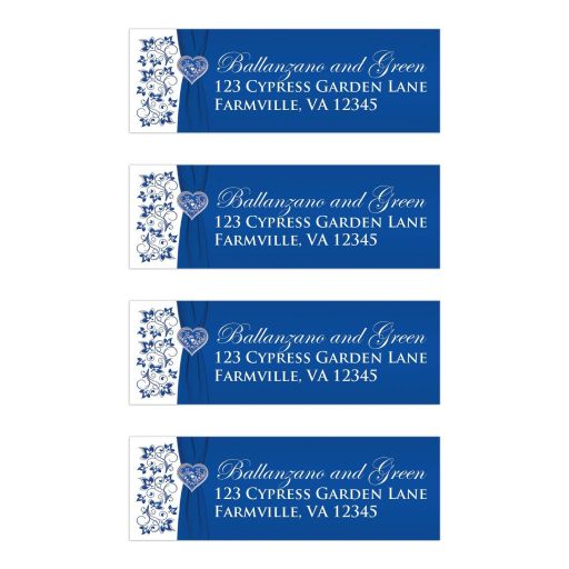 ​Royal blue and white floral wedding return address mailing labels with silver heart brooch, ribbon, and flowers.